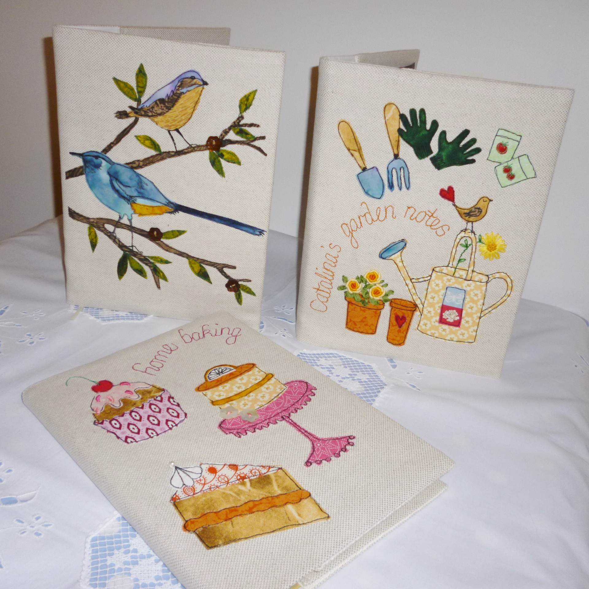 Appliqued fabric covered books